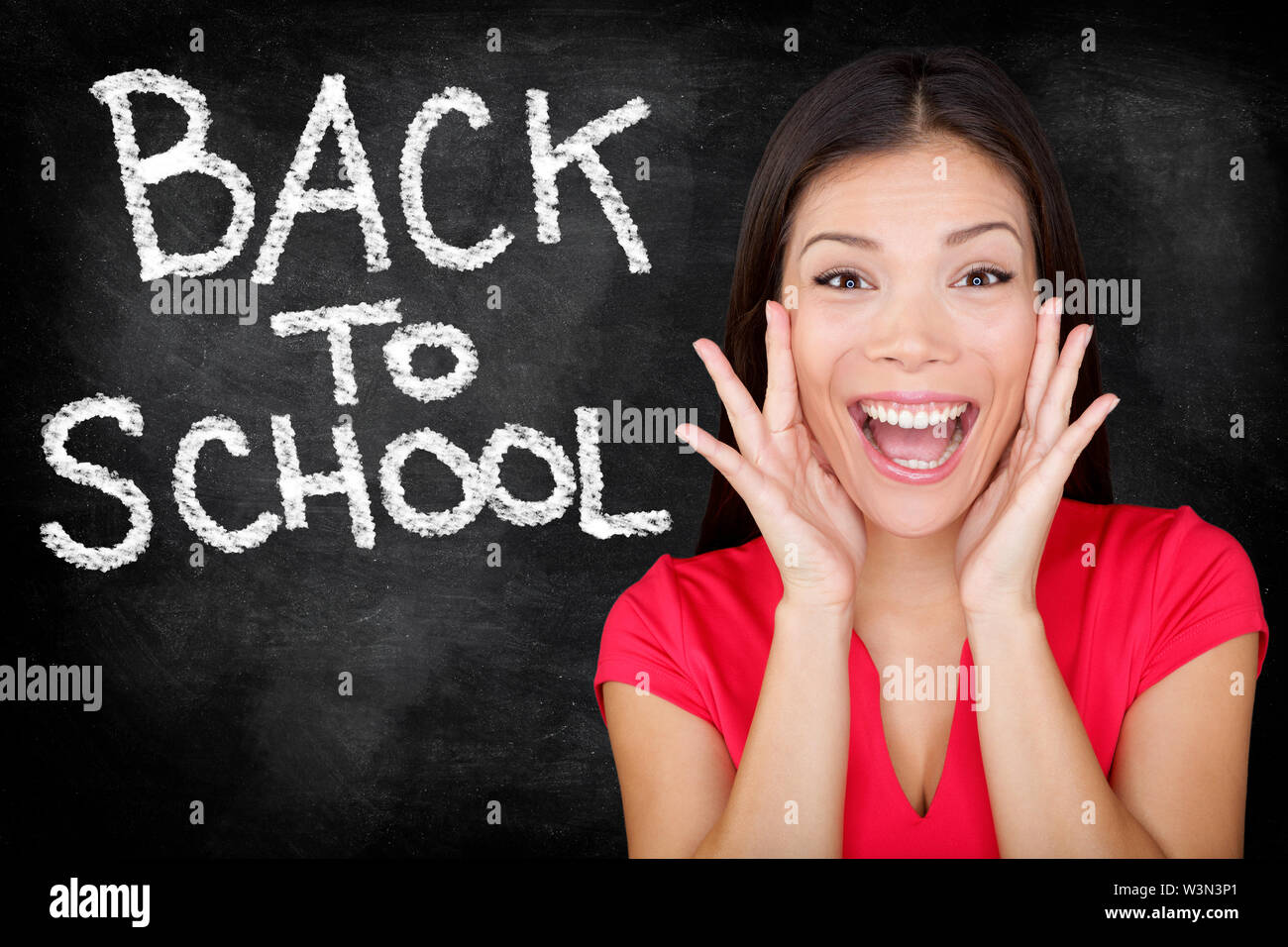 Back to School - university college student teacher screaming excited by blackboard with BACK TO SCHOOL written on chalkboard. Female student or funny woman teacher. - Stock Image