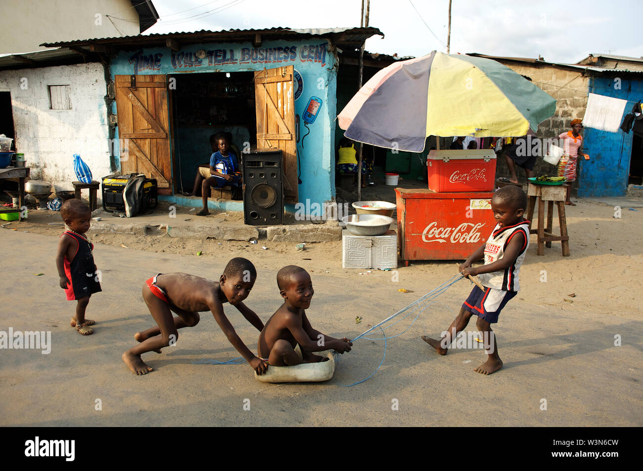 Children play in the West Point, which houses over 70,000 people. It is known to be one of the most dangerous slums in Monrovia. Water and sanitation condition in the slum is certainly less that adequate. Due to the lack of sanitary latrines, it's is common for many residents of the West Point to defecate in open near the beach. It is also common for people to dispose of garbage on the beach that continues to create health hazards for its residents.     In 2012, Liberia is still recovering from a ruinous 14-year civil war that ended in 2003. Although the Government is working to rebuild the co - Stock Image