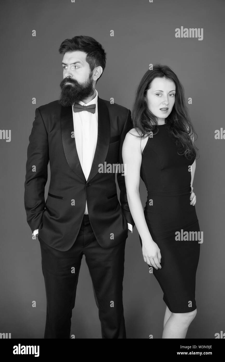 All black dress code. Official event concept. Man bearded wear tuxedo girl elegant dress. Visiting event or ceremony. Couple classy clothes. Elite event. Main rules picking clothes. Corporate party. - Stock Image