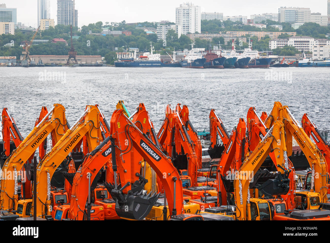VLADIVOSTOK, RUSSIA - JUNE 20, 2019: Imported excavators in the Far Eastern port of the coastal city of Vladivostok are prepared for customs procedure - Stock Image