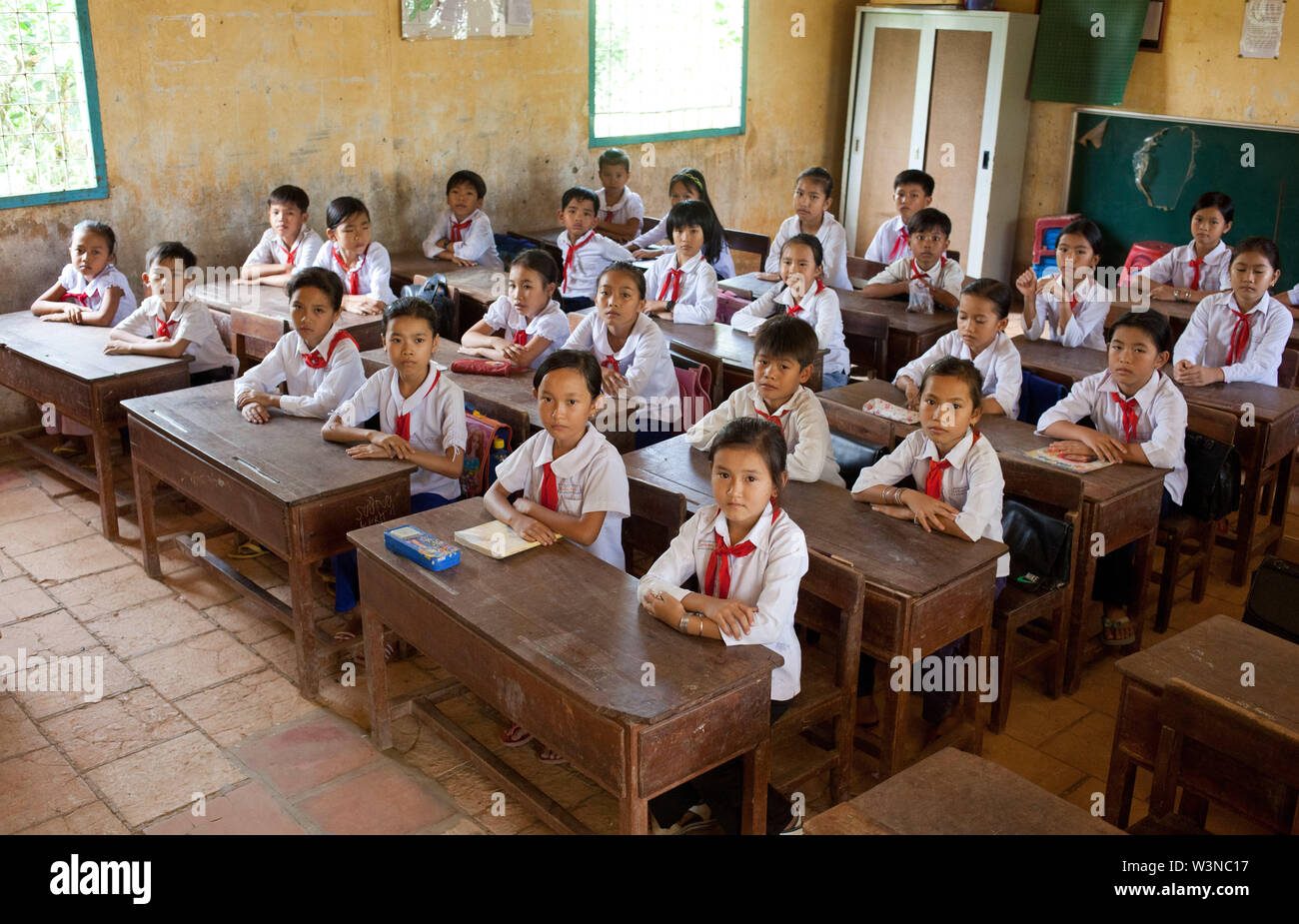 Students sitting  at their desks at school at Kien Phouc School in Tien Giang Province; Outside of Ho Chi Minh City; South Vietnam Asia - Stock Image