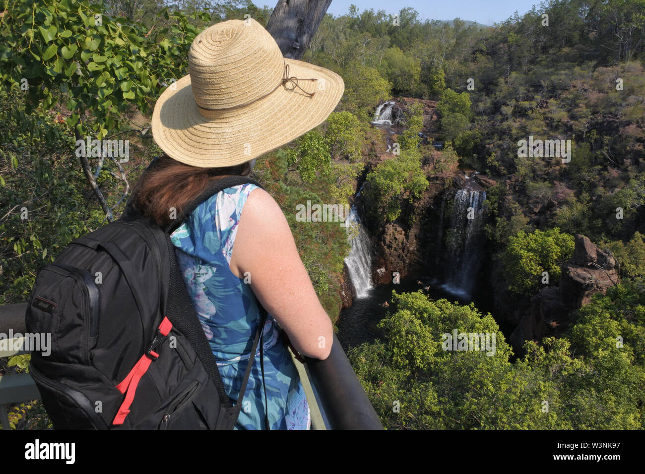 Australian adult woman tourist looking at lorence Falls in Litchfield National Park Northern Territory Australia - Stock Image