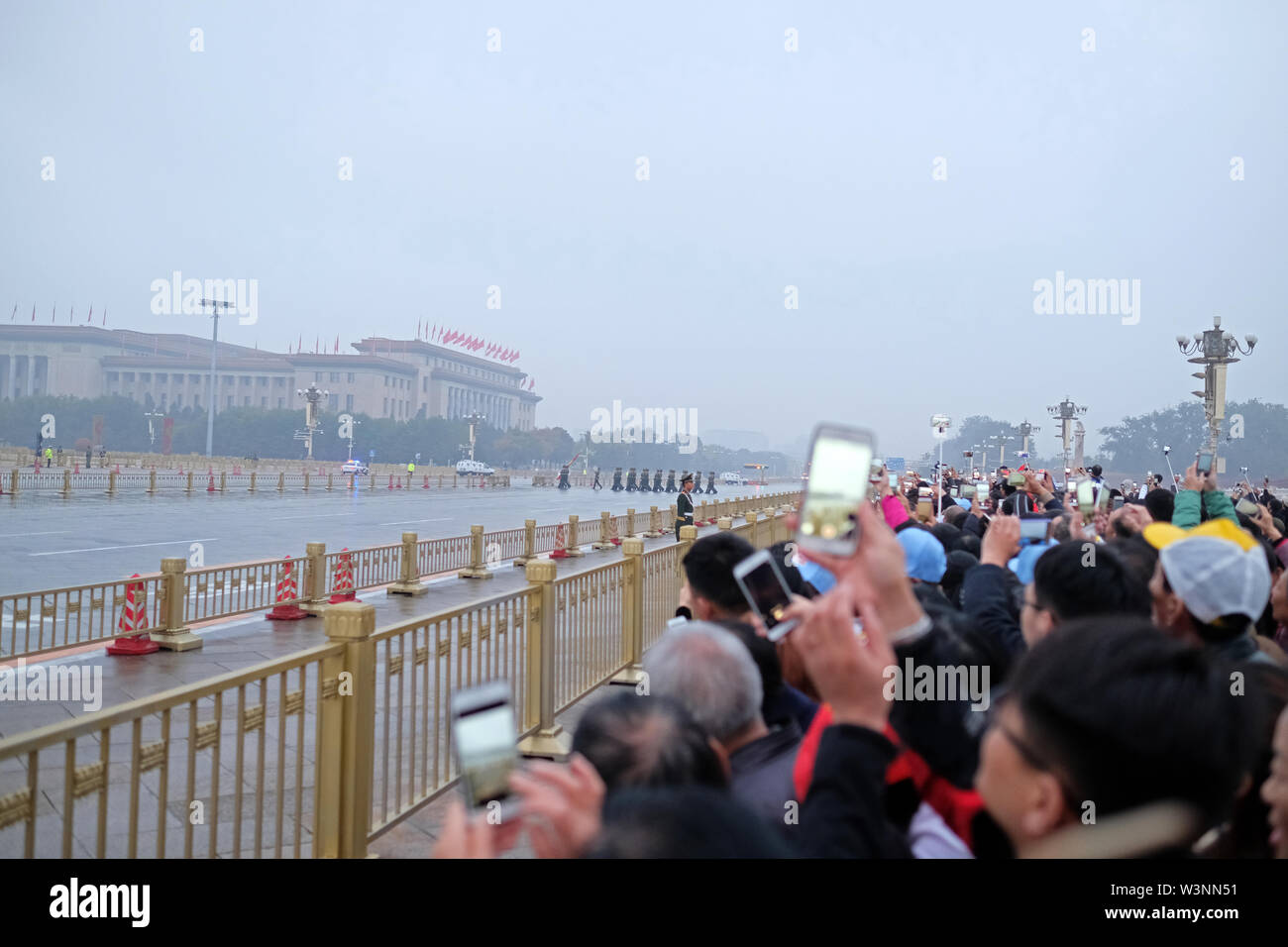 lots of people with cameras and cellphone outside of the forbidden city in beijing - Stock Image