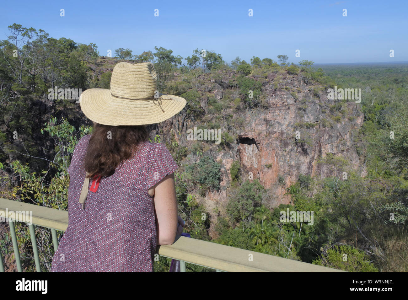 Australian woman tourist looking at the landscape view of Litchfield National Park Northern Territory Australia - Stock Image