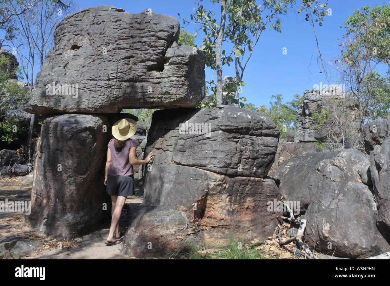 Young Australian adult woman tourist visit in the lost city at Litchfield National Park Northern Territory Australia - Stock Image