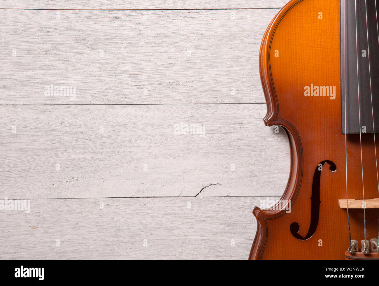still life of vintage violin on white wooden background - Stock Image