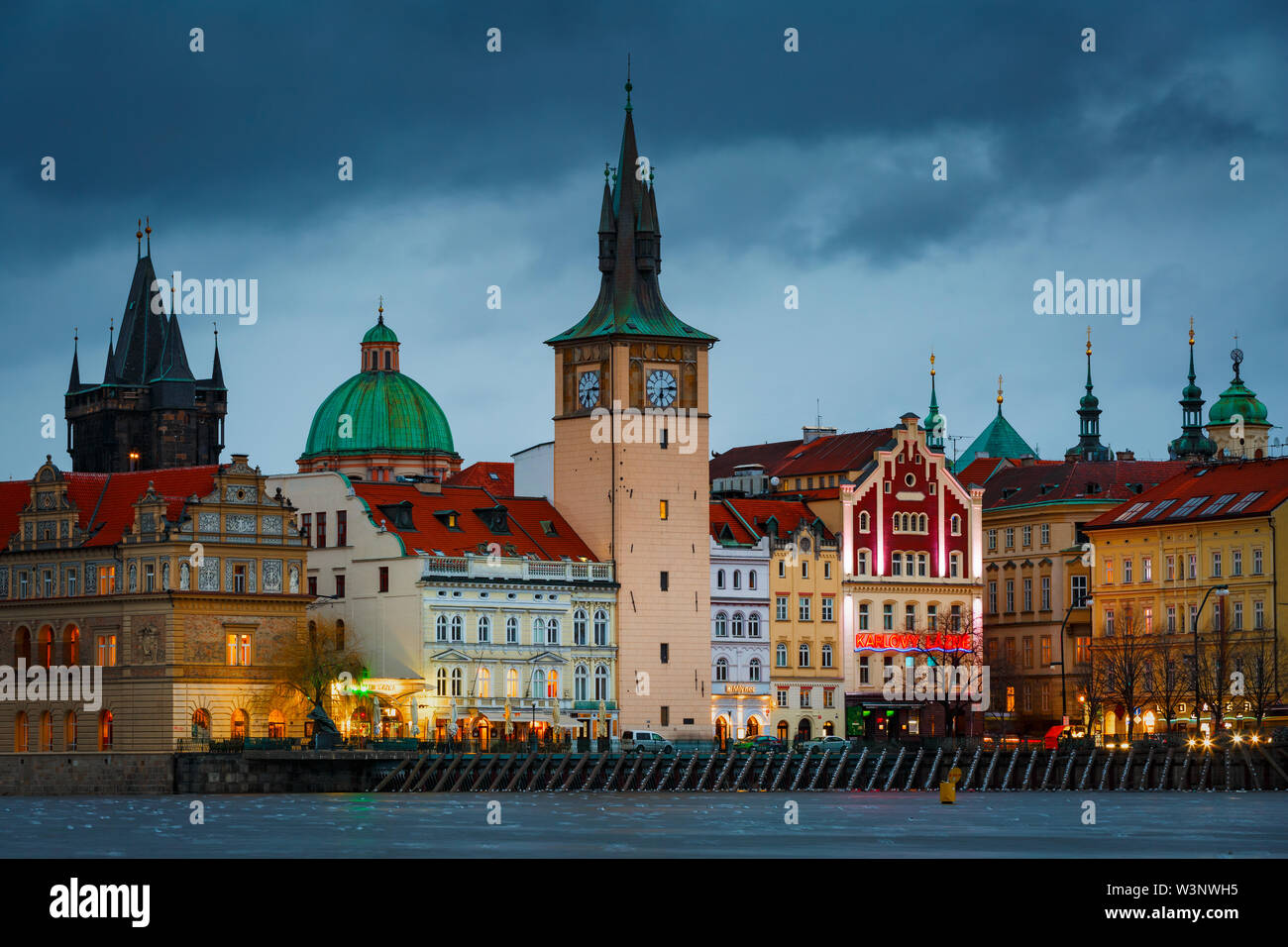 Prague, Czech Republic - March 14, 2019: Evening view of the historical city centre of Prague from Strelecky island. - Stock Image