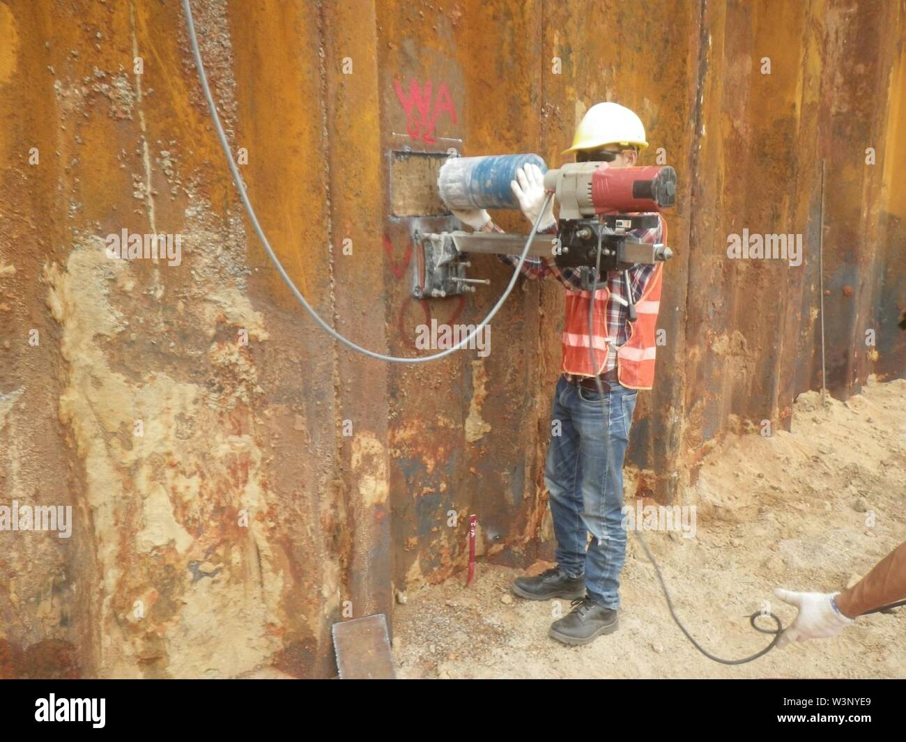 Collecting a concrete core sample of the containment structure to analyze the insulating value after Phase 1 treatment. (26783265476). - Stock Image