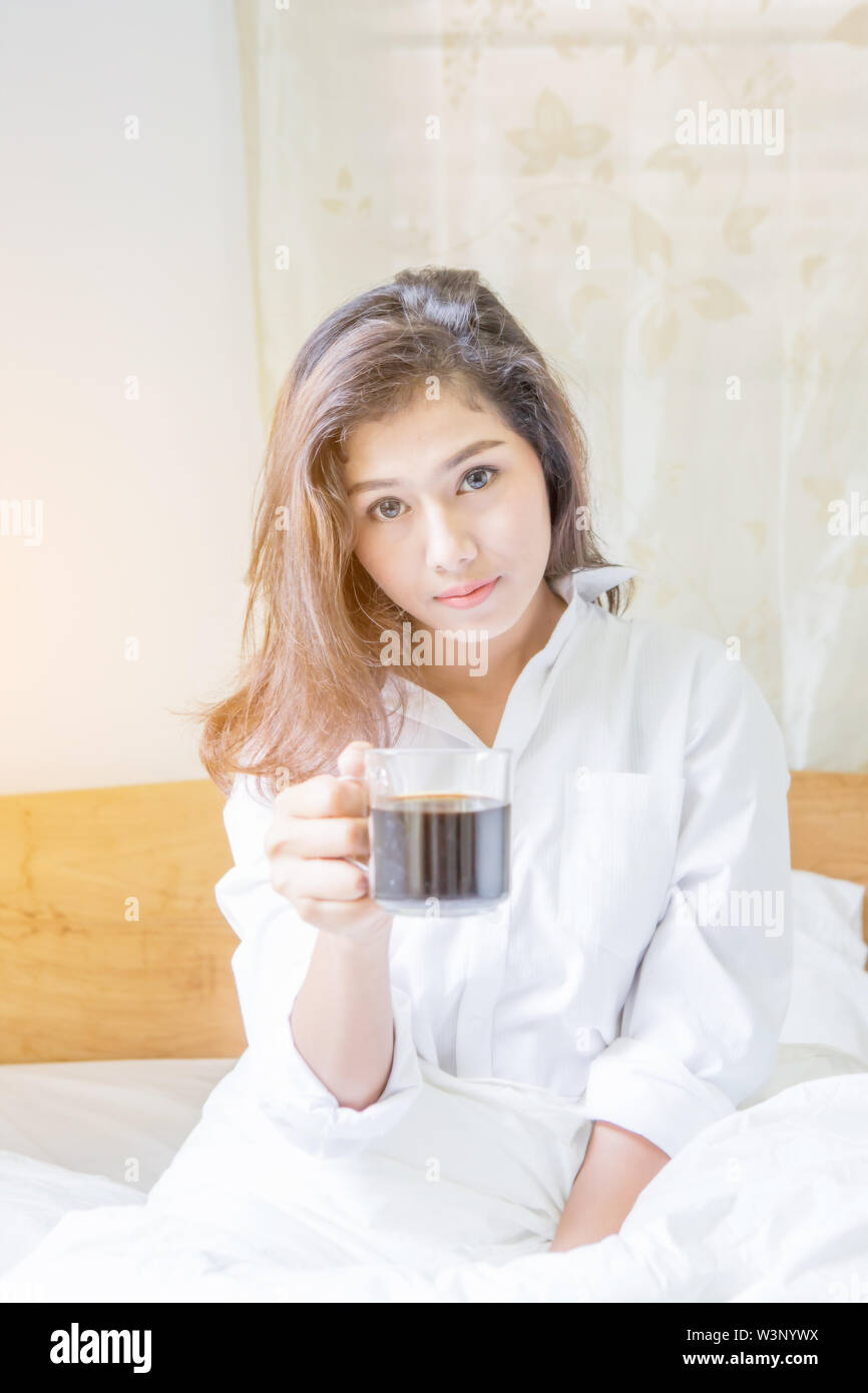 beautiful woman have coffee in bed - Stock Image