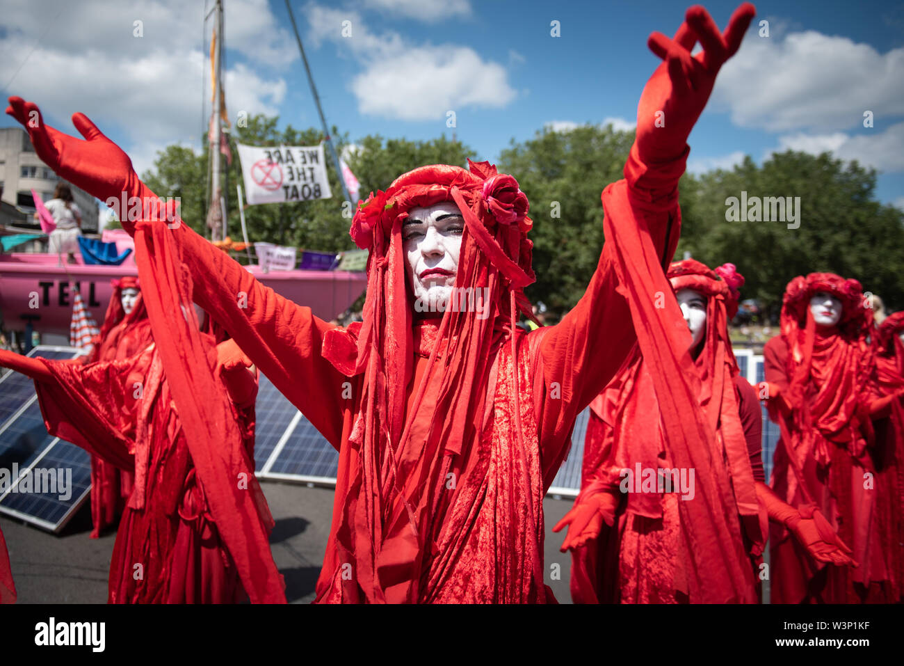 Bristol, UK. 15th July 2019.  Hundreds of Extinction Rebellion protesters block Bristol Bridge using a pink sailing boat and march through the streets Stock Photo