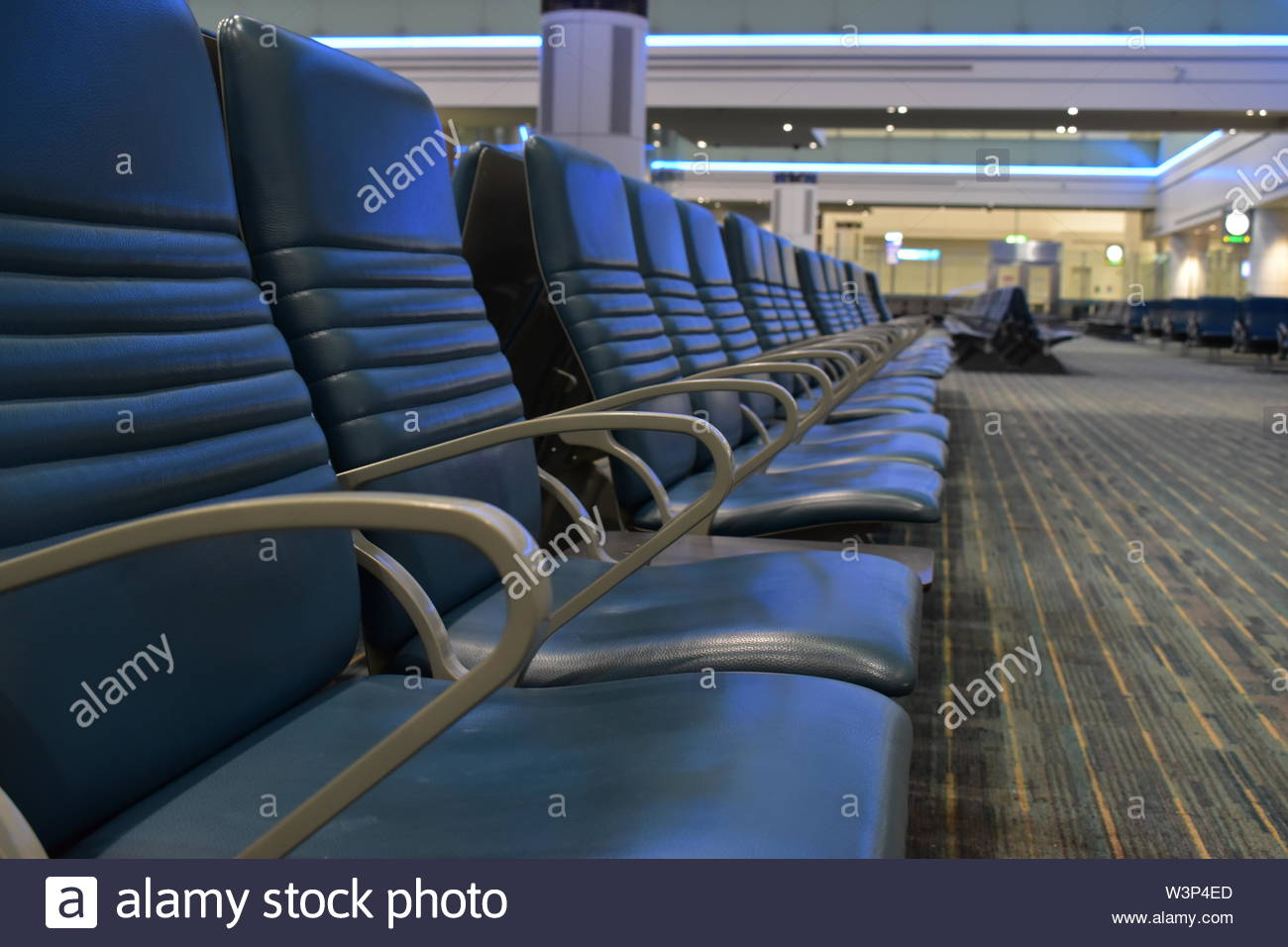 Picture of a large empty waiting room with rows of comfortable seats, decrease of activity, crisis background, concept. - Stock Image