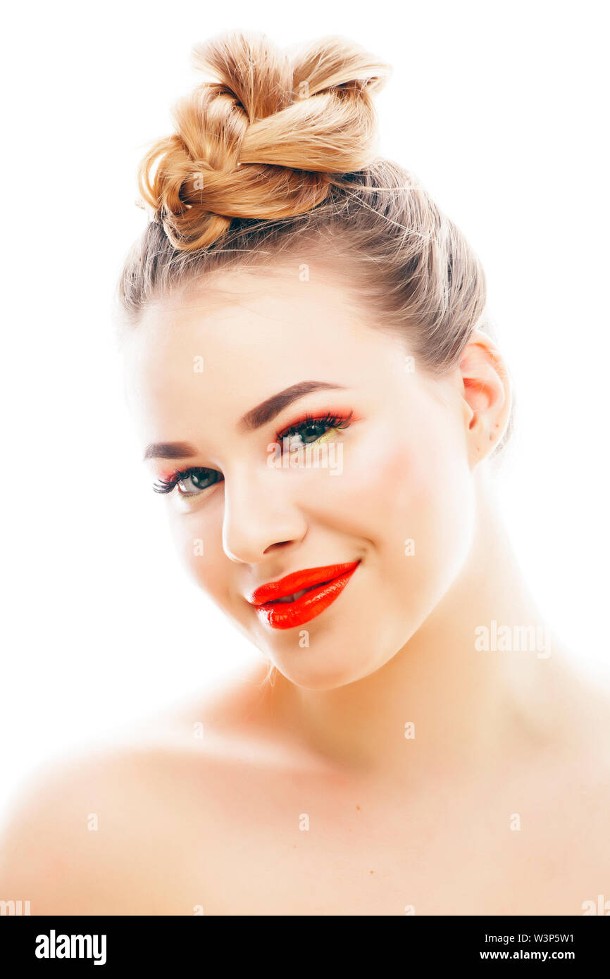 young blond woman with bright make up smiling pointing gesturing emotional isolated like doll lashes on white, real people concept - Stock Image