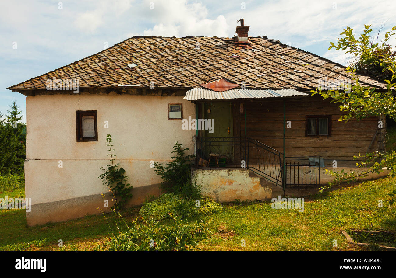 Exterior of an old village house during day. Stock Photo