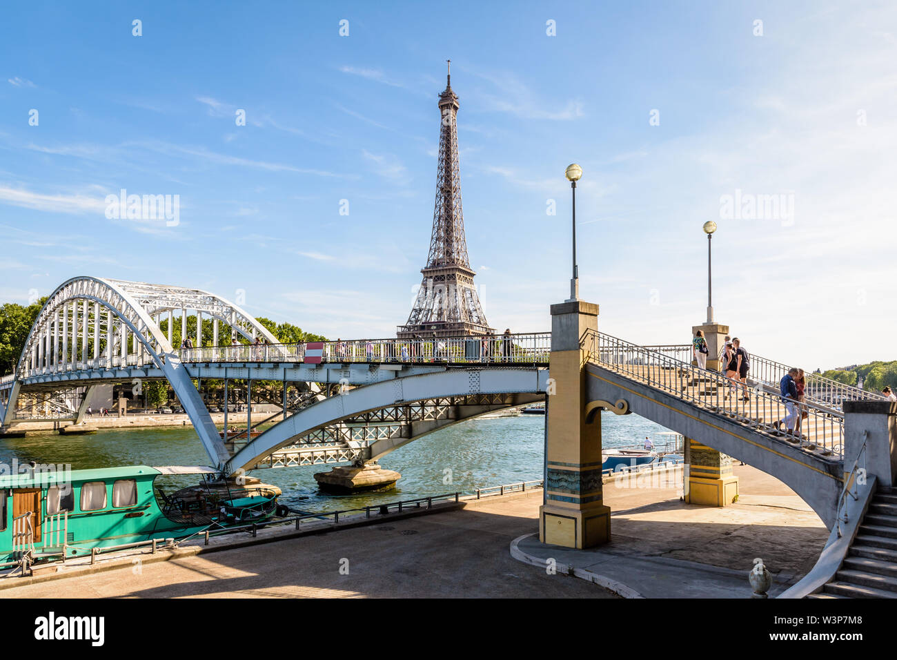The Debilly footbridge is a pedestrian through arch bridge over the river Seine, built in 1900 not far from the Eiffel tower in Paris, France. - Stock Image