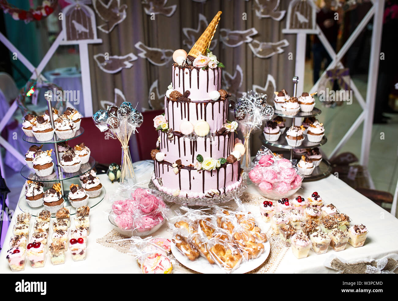 Candy bar. Dessert table for a party, sweet treat and dessert. - Stock Image