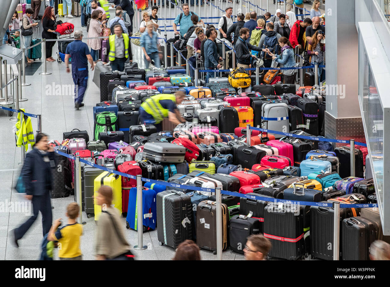 Duesseldorf, Germany. 17th July, 2019. Several hundred pieces of luggage are standing in the departure hall of Düsseldorf Airport. Due to a technical malfunction, passengers at Düsseldorf Airport had to adjust to problems with baggage handling. Credit: Marcel Kusch/dpa/Alamy Live News - Stock Image
