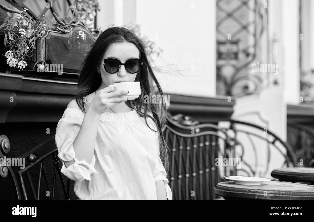 Breakfast time in cafe. Girl enjoy morning coffee. Woman drink coffee outdoors. Peaceful inspiring moment. Girl relax in cafe cappuccino cup. Caffeine - Stock Image