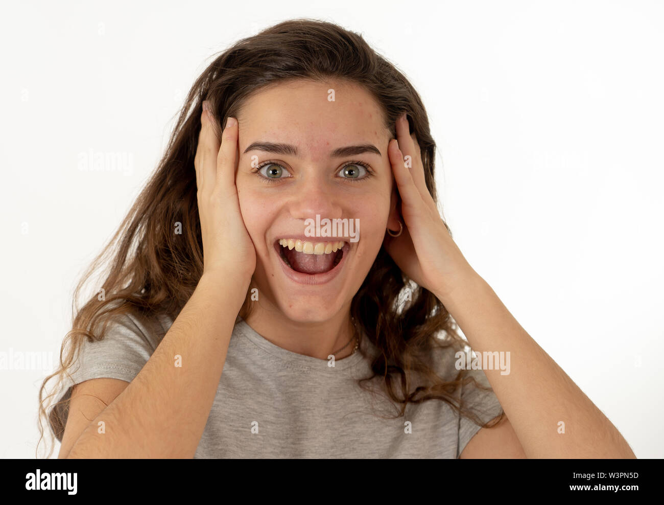 Portrait of beautiful shocked girl celebrating victory, having great success with surprised and happy Face and gestures. In Facial Expression, Human E - Stock Image