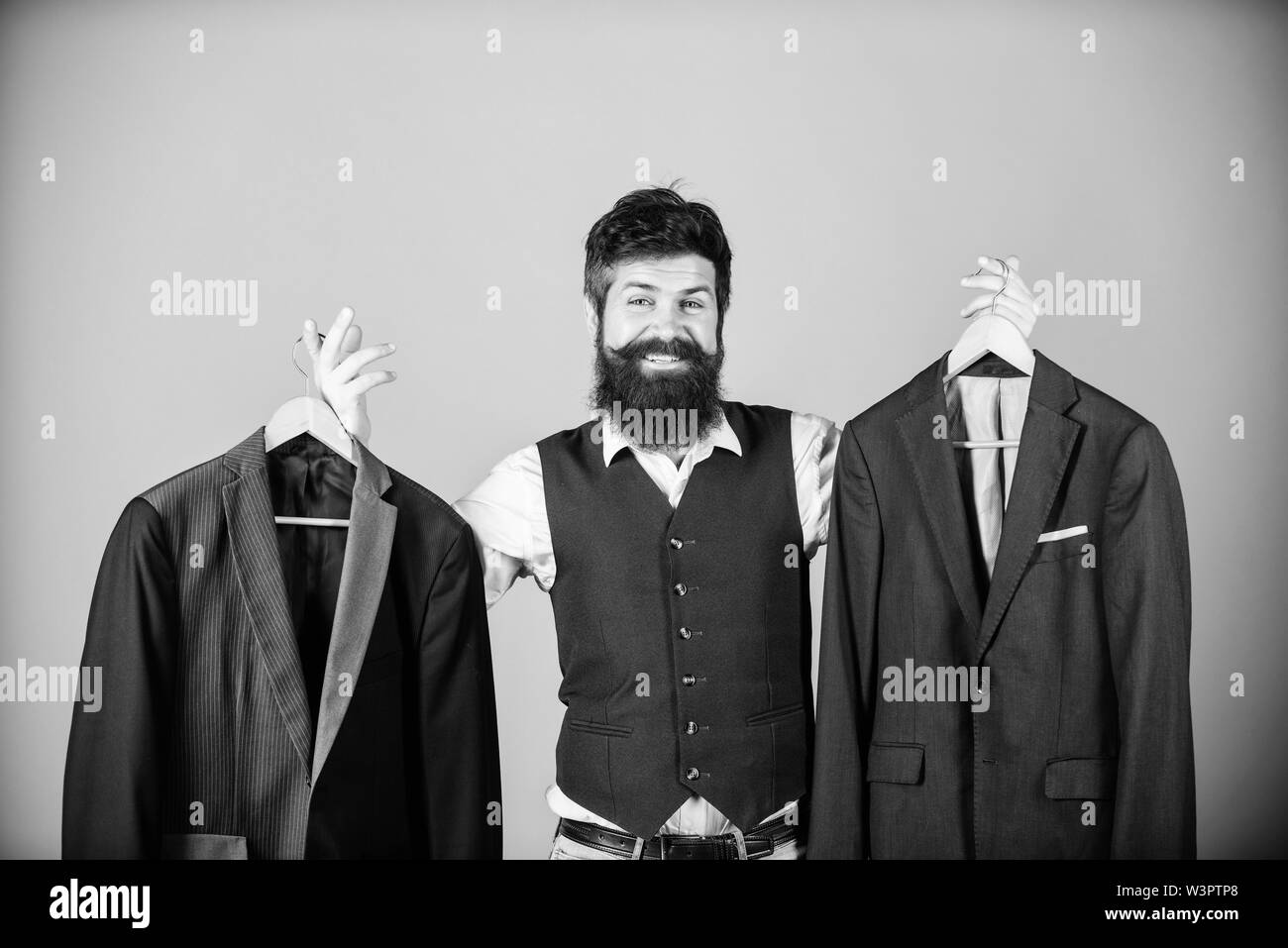 Man bearded fashion couturier tailor. Elegant custom outfit. Tailoring and clothes design. Perfect fit. Custom made to measure. Tailored suit concept. Designing made to measure suit. Custom made suit. - Stock Image