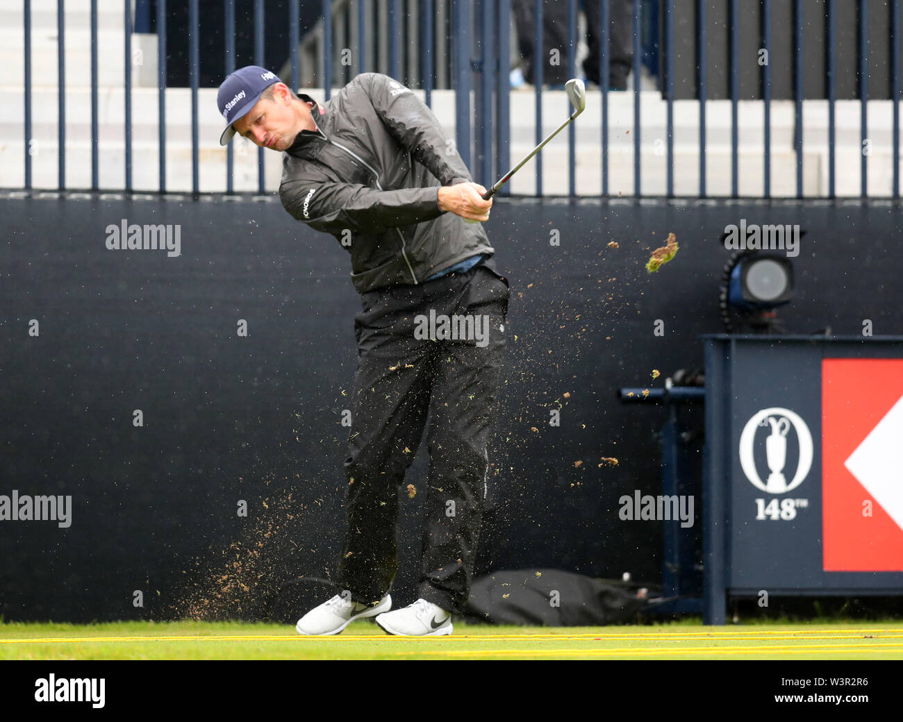 Portrush, County Antrim, Northern Ireland. 17th July 2019. The 148th Open Golf Championship, Royal Portrush Golf Club, Practice day ; Justin Rose (ENG) hits a short iron from the tee at the par three 13th hole Credit: Action Plus Sports Images/Alamy Live News Stock Photo