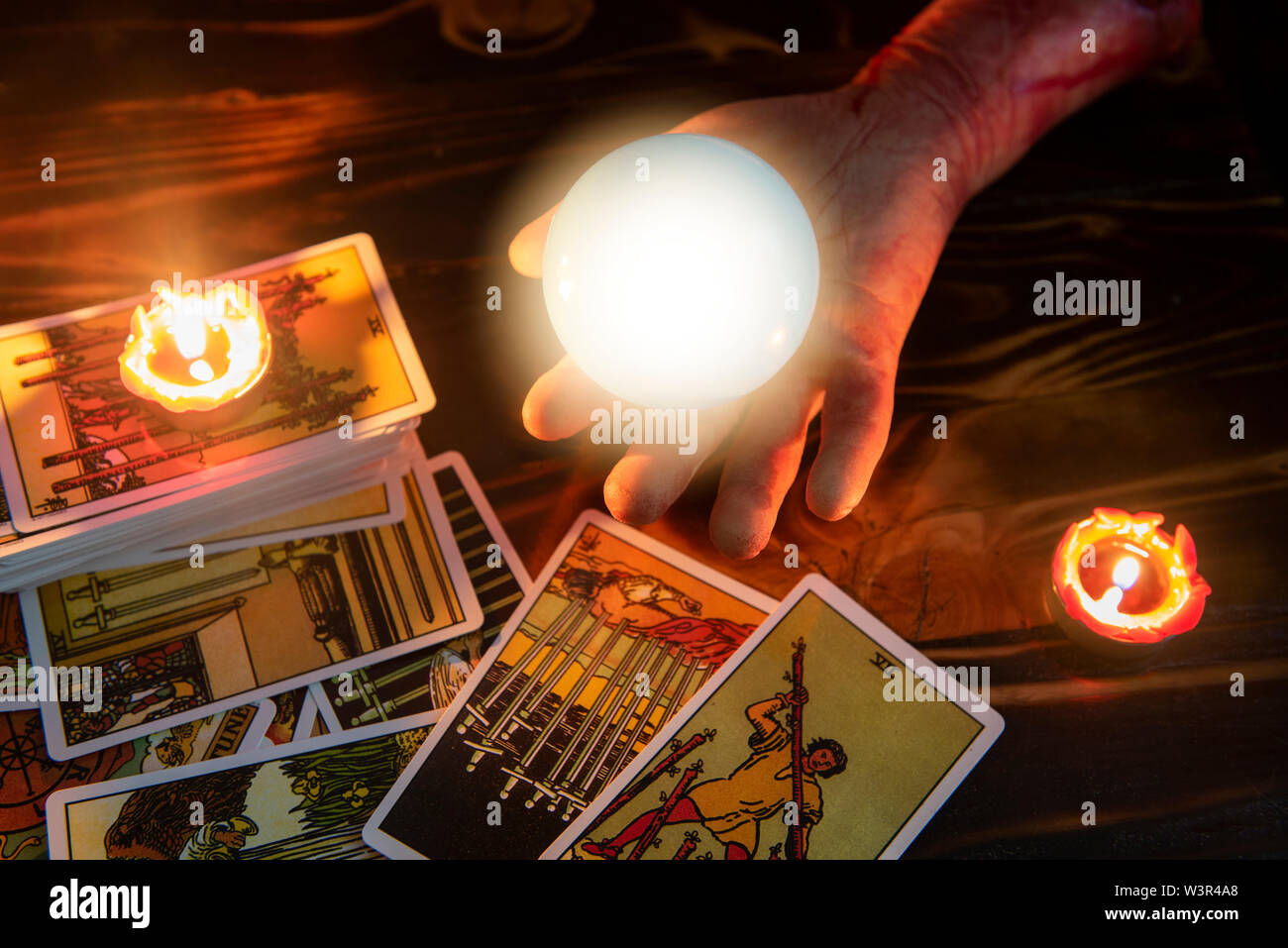 Tarot cards and crystal ball reading psychic by zombie hand