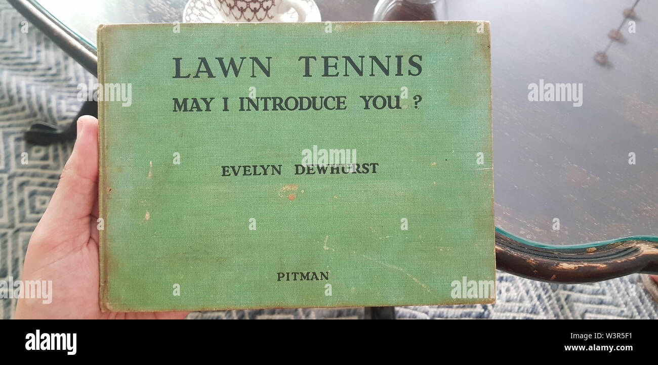 Cover of Lawn Tennis. May I Introduce you? How to play tennis book by Evelyn Dewhurst with sketches by Aubrey Weber. Published in London by Sir Isaac - Stock Image