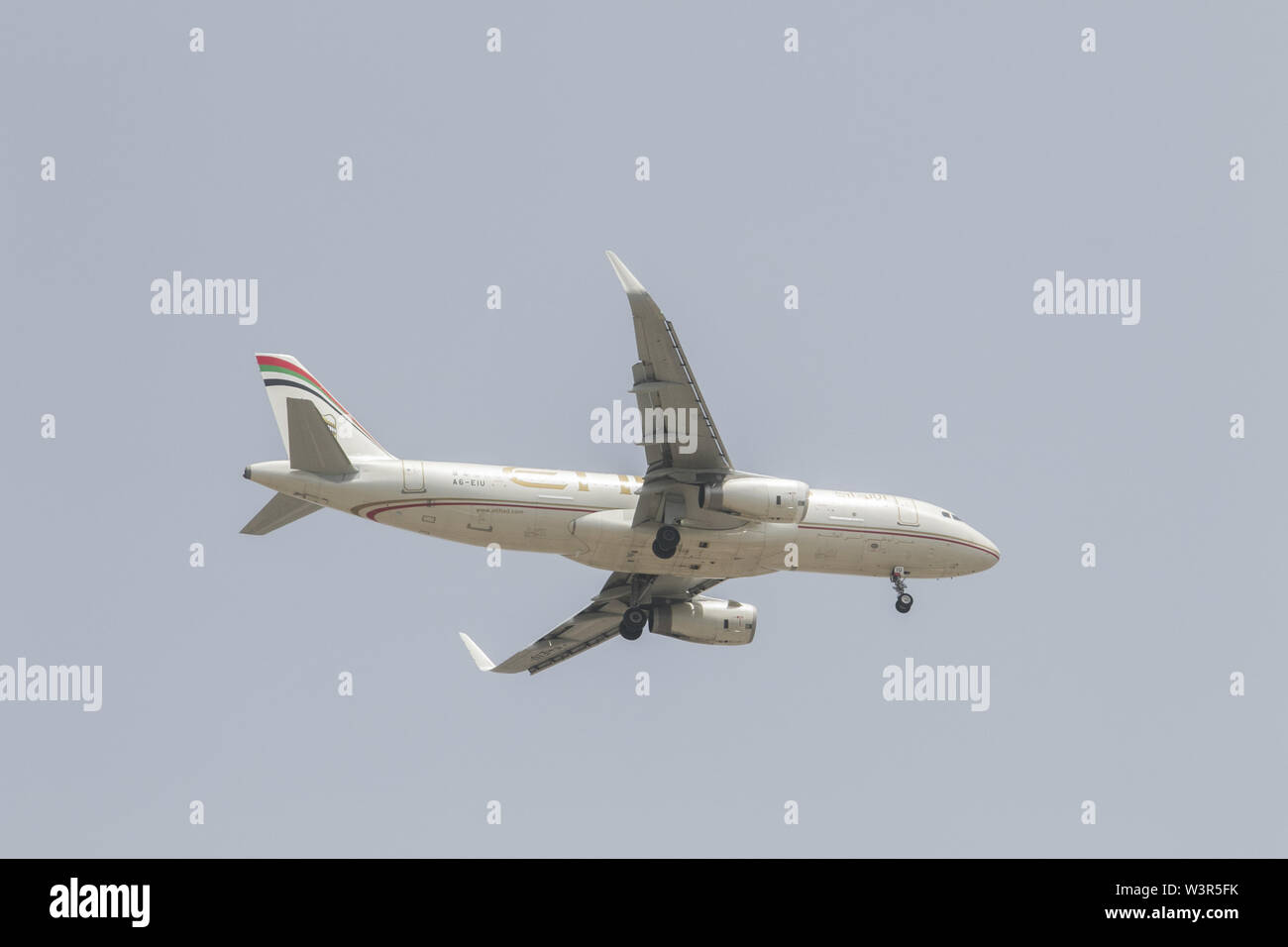 Beirut, Lebanon. 17th July, 2019. The undercarriage of an Etihad commercial passenger jet prepars to land at Rafic Hariri International Airport in Beirut. Credit: Amer Ghazzal/SOPA Images/ZUMA Wire/Alamy Live News - Stock Image