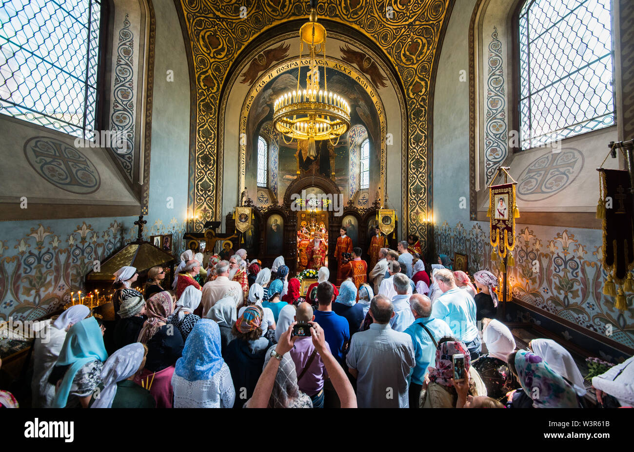 Darmstadt, Germany. 17th July, 2019. Believers take part in the service. The Russian Orthodox Church on Mathildenhöhe commemorates the murder of the last Russian tsar family on 17 July 1918 with a divine service. Subsequently, bell models were symbolically handed over for the seven new bells. The new bells, which are not yet completely finished, will be consecrated at a later date. Credit: Andreas Arnold/dpa/Alamy Live News - Stock Image