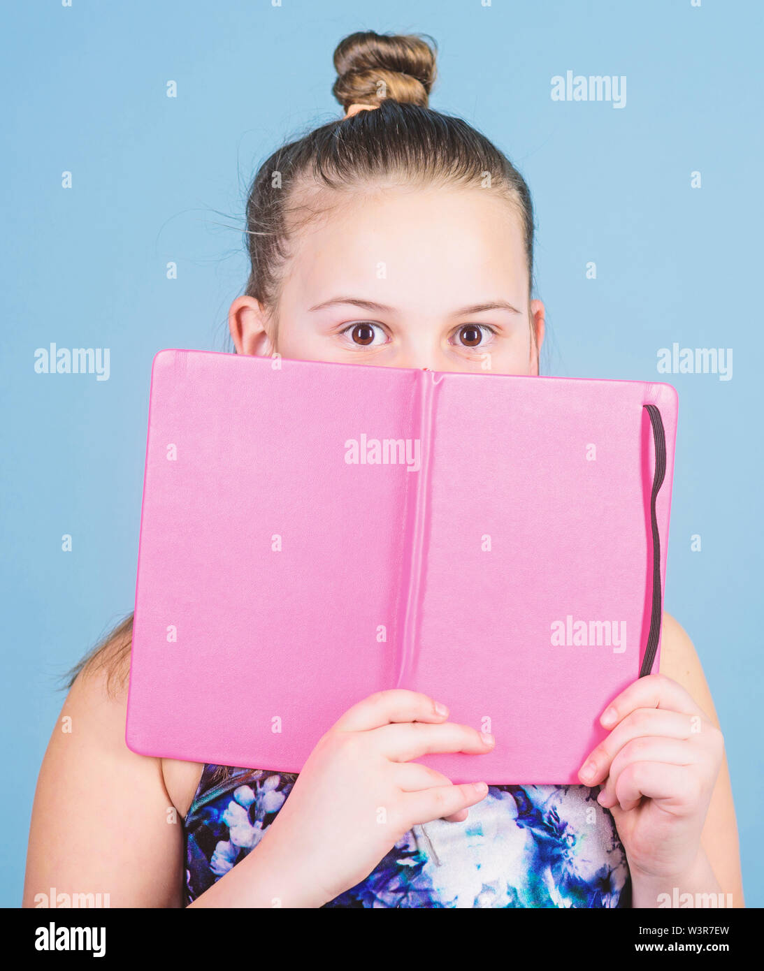 learn reading books. secret story. workbooks for writing. school diaries for making notes. small girl with note book. school child with notepad. educa - Stock Image