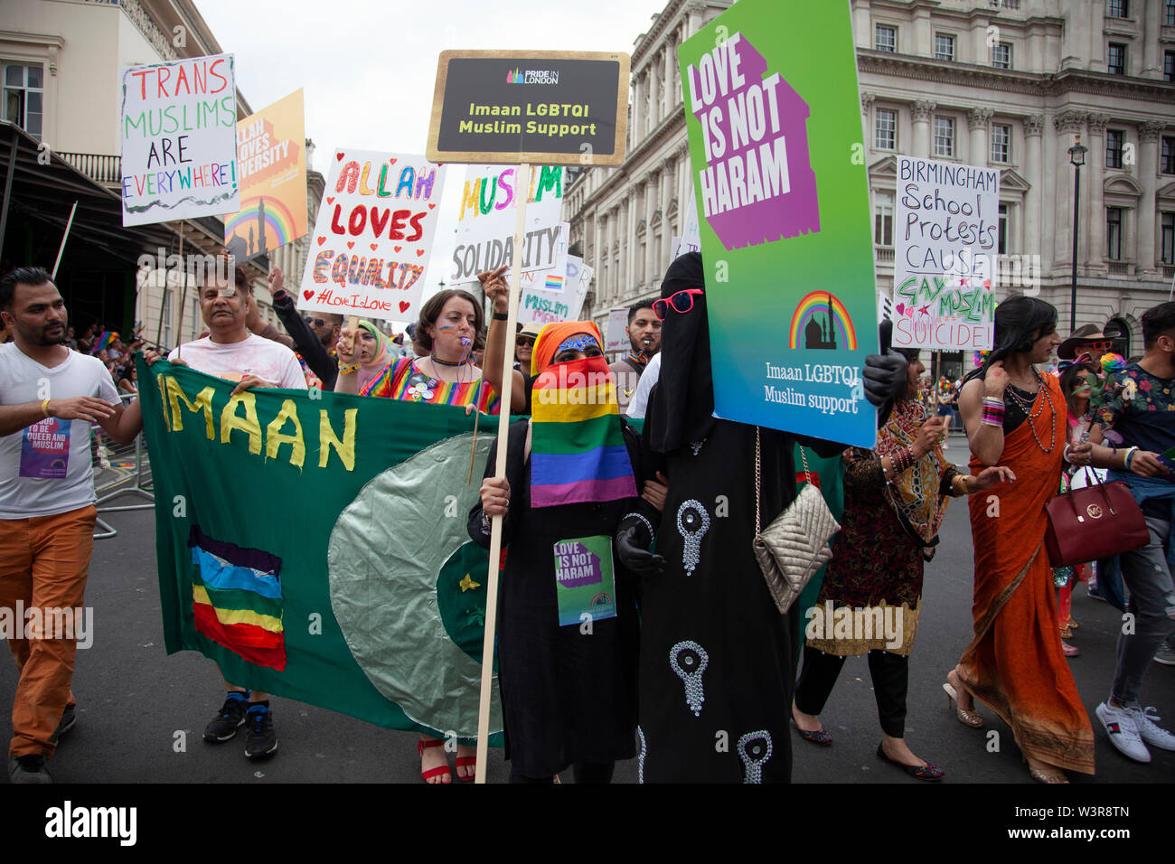 LONDON, UK - July 6th 2019: A muslim woman wearing a gay pride burka at the annual gay pride march in central London - Stock Image
