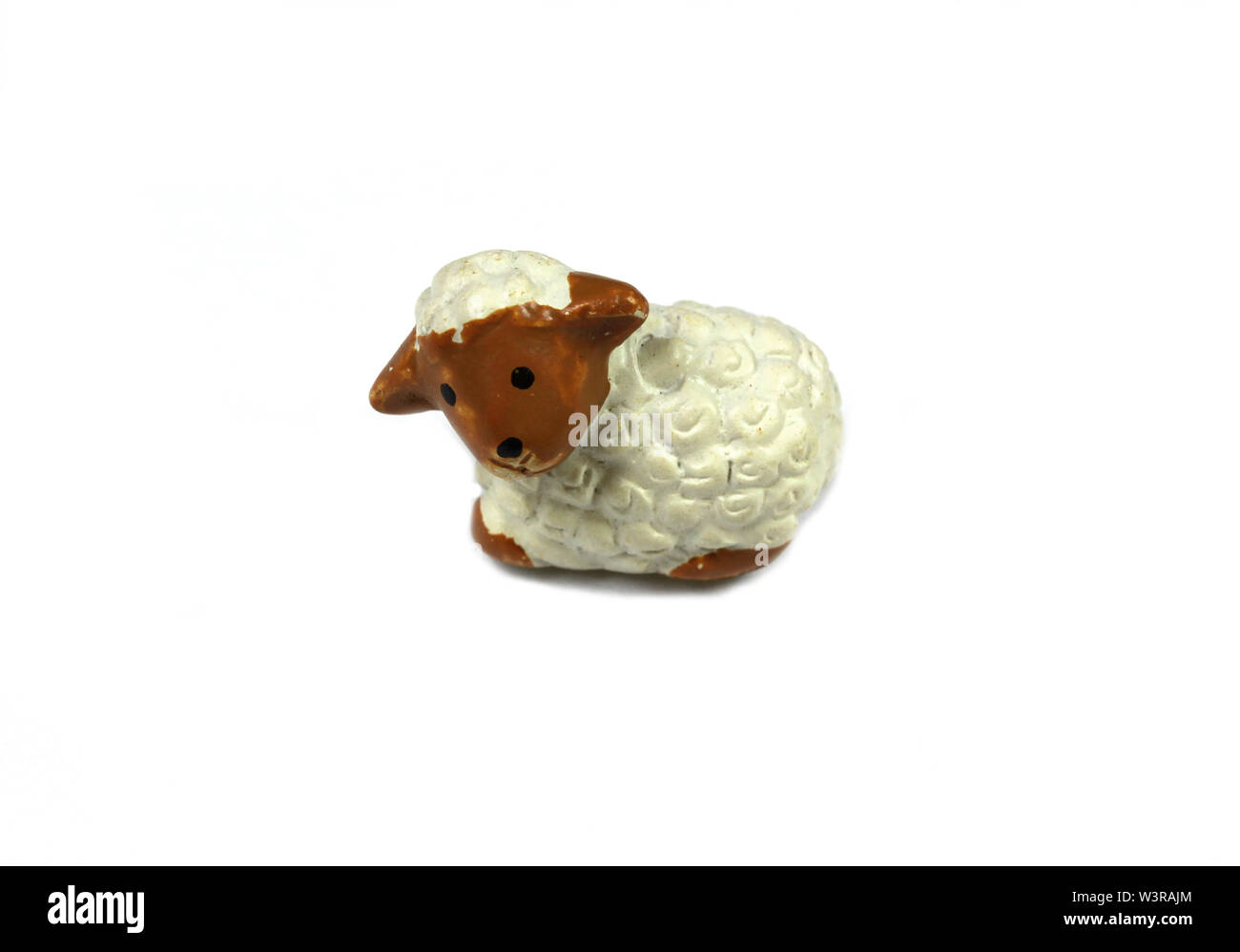 Small lamb figure over white background - Stock Image