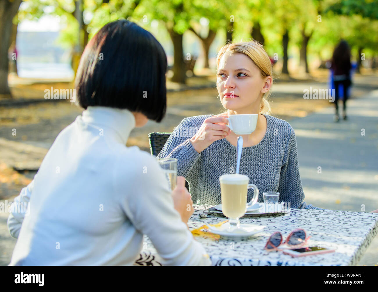 Discussing rumors. Trustful communication. Friendship sisters. Friendship meeting. Female leisure. Girls friends drink coffee talk. Conversation women - Stock Image