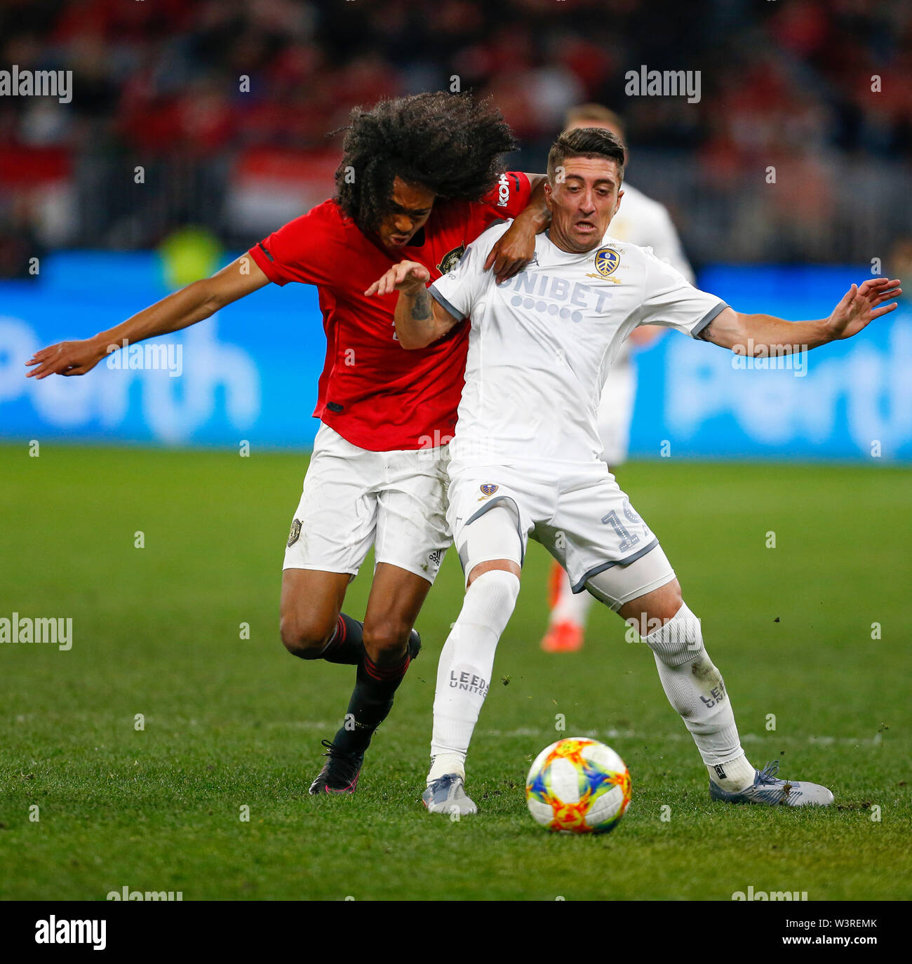 Optus Stadium, Burswood, Perth, W Australia. 17th July 2019. Manchester United versus Leeds United; pre-season tour; Pablo Hernandez of Leeds United holds off Tahith Chong of Manchester United Credit: Action Plus Sports Images/Alamy Live News Stock Photo