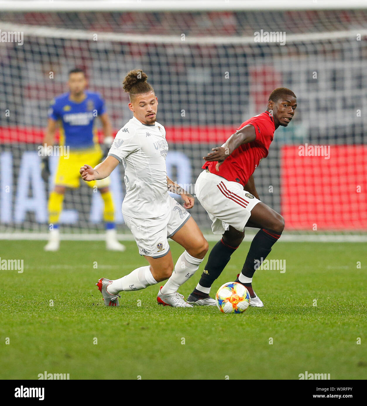 Optus Stadium, Burswood, Perth, W Australia. 17th July 2019. Manchester United versus Leeds United; pre-season tour; Kalvin Phillips of Leeds United chases the loose ball ahead of Paul Pogba of Manchester United Credit: Action Plus Sports Images/Alamy Live News Stock Photo