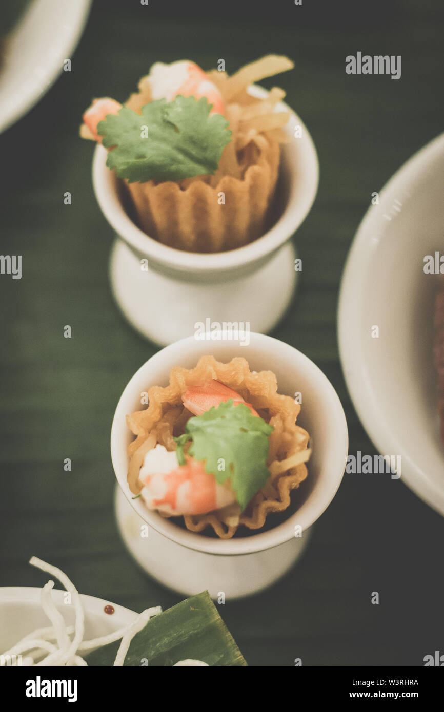 Kueh Pie Ti Delicate crisp Top Hats filled with stewed julienned turnip and condiments, topped with prawn. - Stock Image