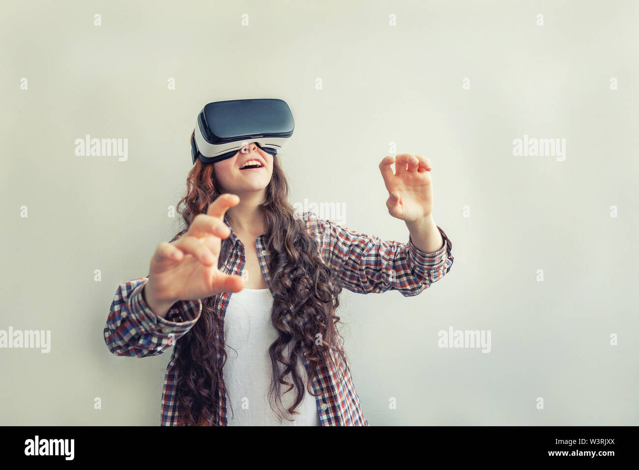 Young Woman Using Electronic Device Stock Photos & Young