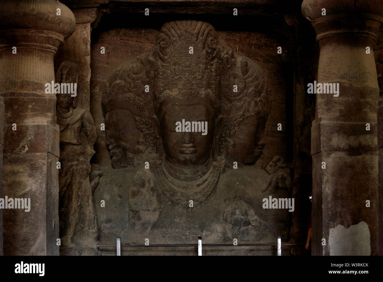 Sadasiva: Trimurti as aspects of Shiva: creation, protection, and destruction in Elephanta Caves a UNESCO World Heritage Site Mumbai maharashtra INDIA - Stock Image