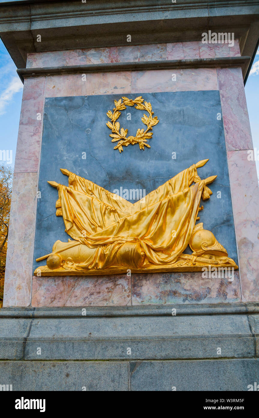 St Petersburg, Russia - October 3, 2016. Allegorical composition with trophies at the stone panel on the monument to Peter I in St Petersburg, Russia - Stock Image