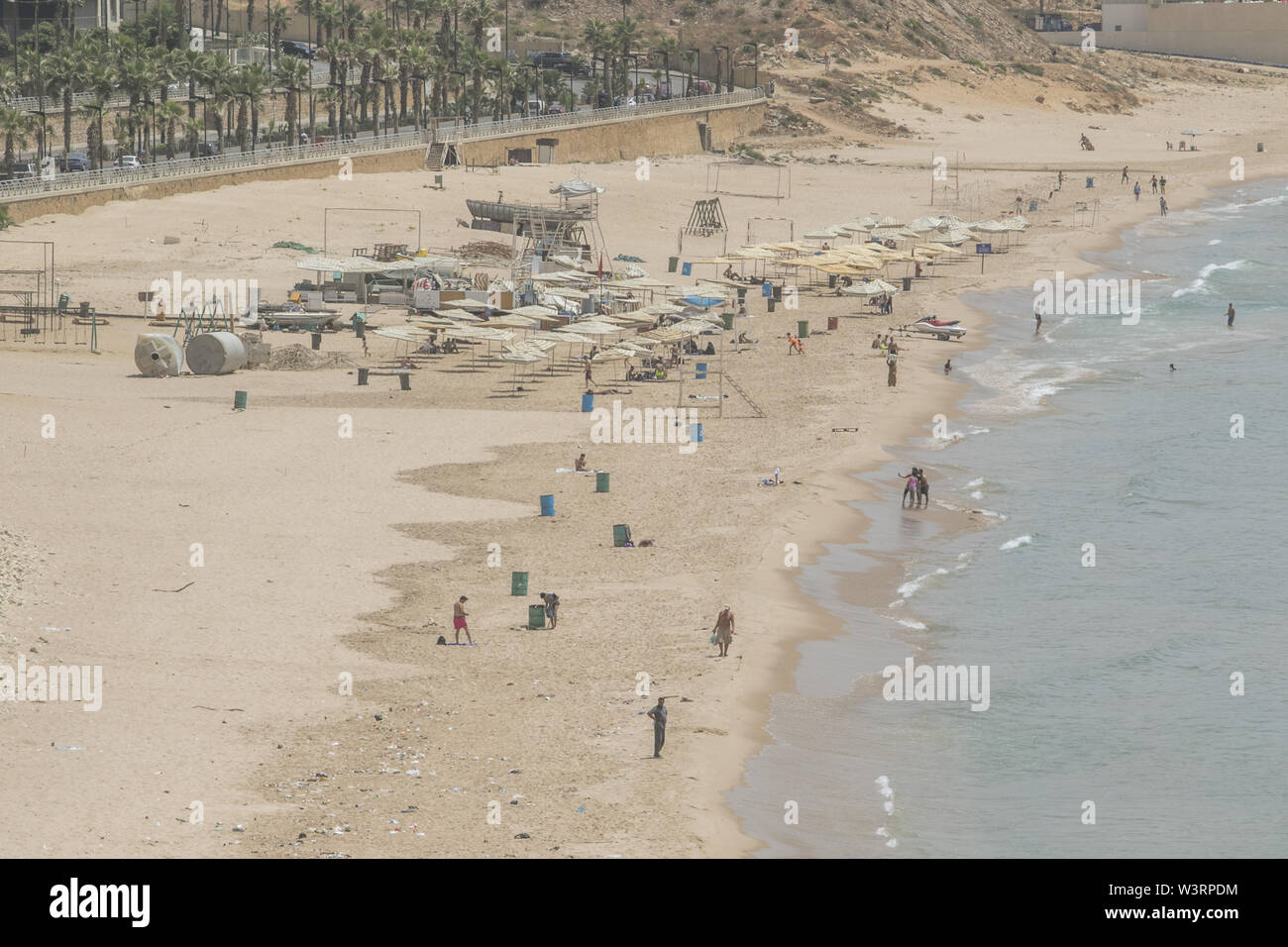 Beirut, Lebanon. 17th July, 2019. People cool off at the beach in Beirut during a sweltering day as temperatures exceed 40 degrees Celsius. Credit: Amer Ghazzal/SOPA Images/ZUMA Wire/Alamy Live News - Stock Image