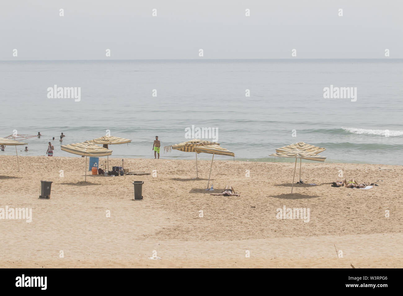 Beirut, Lebanon. 17th July, 2019. Parasols used at the beach during a sweltering day as temperatures exceed 40 degrees Celsius. Credit: Amer Ghazzal/SOPA Images/ZUMA Wire/Alamy Live News - Stock Image