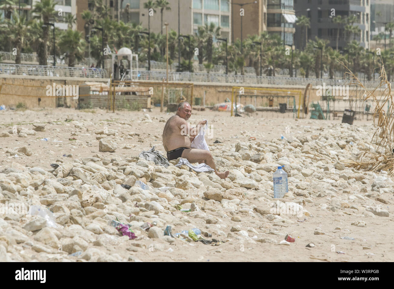 Beirut, Lebanon. 17th July, 2019. A man cools off at the beach in Beirut during a sweltering day as temperatures exceed 40 degrees Celsius. Credit: Amer Ghazzal/SOPA Images/ZUMA Wire/Alamy Live News - Stock Image