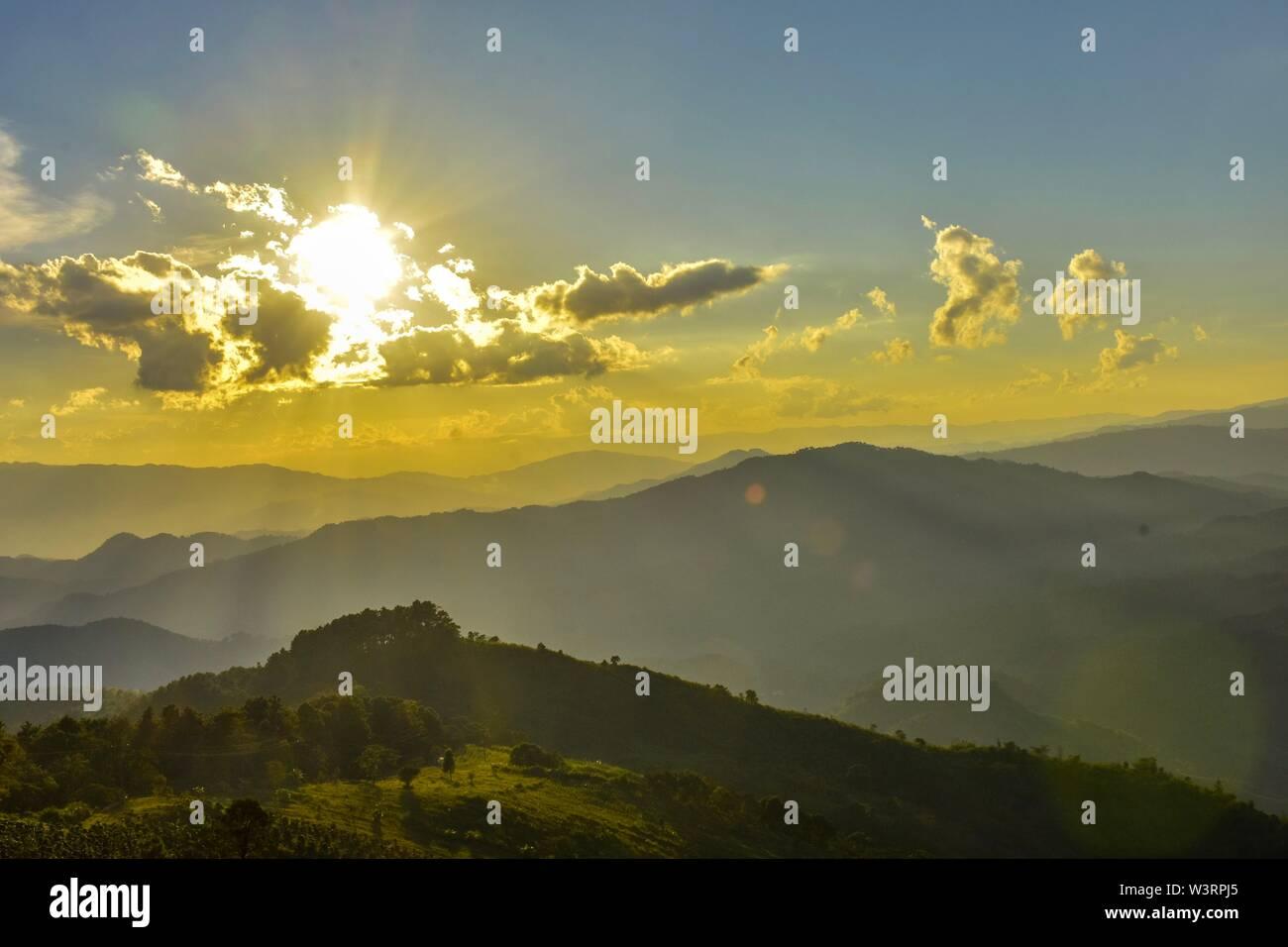 Sunset at Doi Chang Mub   Mae Fa Luang  Chiang Rai   Thailand . - Stock Image