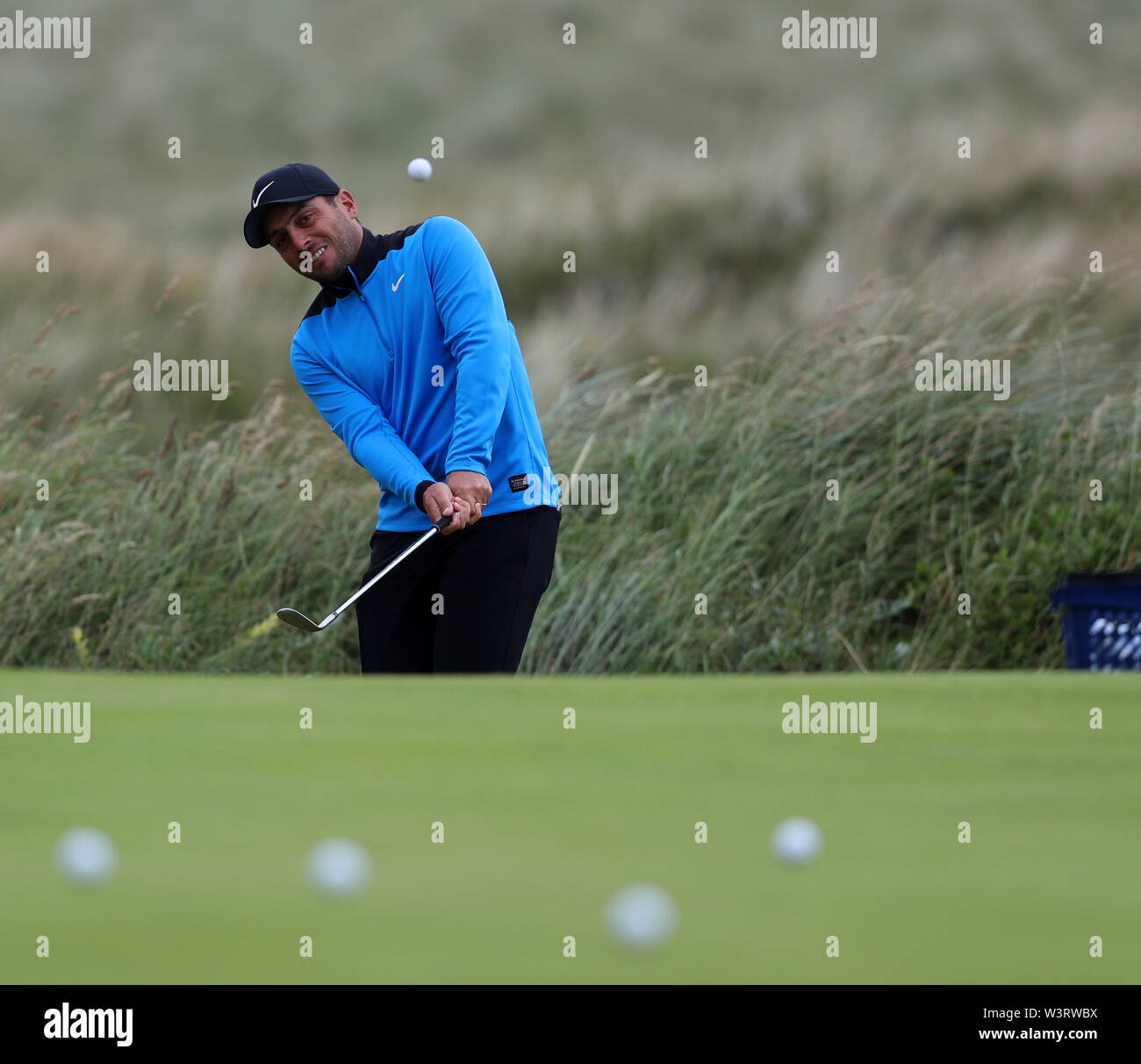 Portrush, Country Antrim, Northern Ireland. 17th July, 2019. The 148th Open Golf Championship, Royal Portrush Golf Club, Practice day; defending Open Champion Francesco Molinari (ITA) practices a pitch shot Credit: Action Plus Sports Images/Alamy Live News Stock Photo