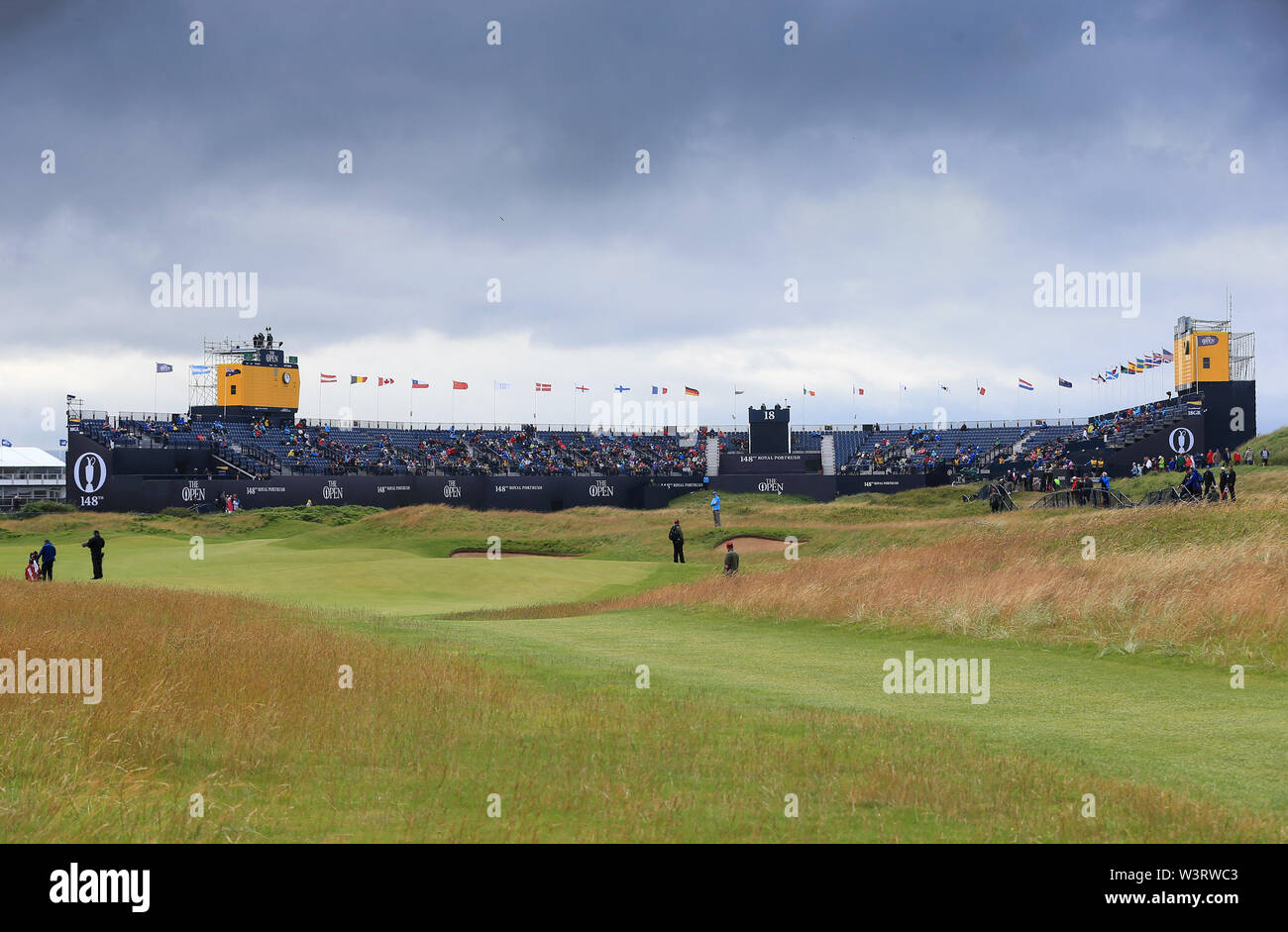 Portrush, Country Antrim, Northern Ireland. 17th July, 2019. The 148th Open Golf Championship, Royal Portrush Golf Club, Practice day; a view of the 18th hole and grandstands surrounding the green Credit: Action Plus Sports Images/Alamy Live News Stock Photo