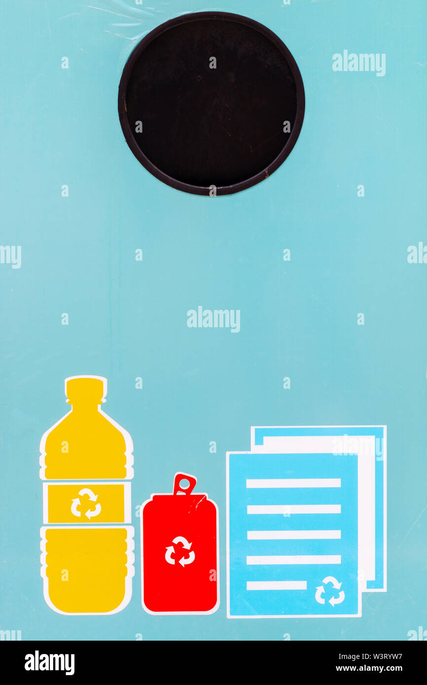 Close up of blue recycle bin with recycle symbol for various type of garbage, plastic, cans and paper. - Stock Image