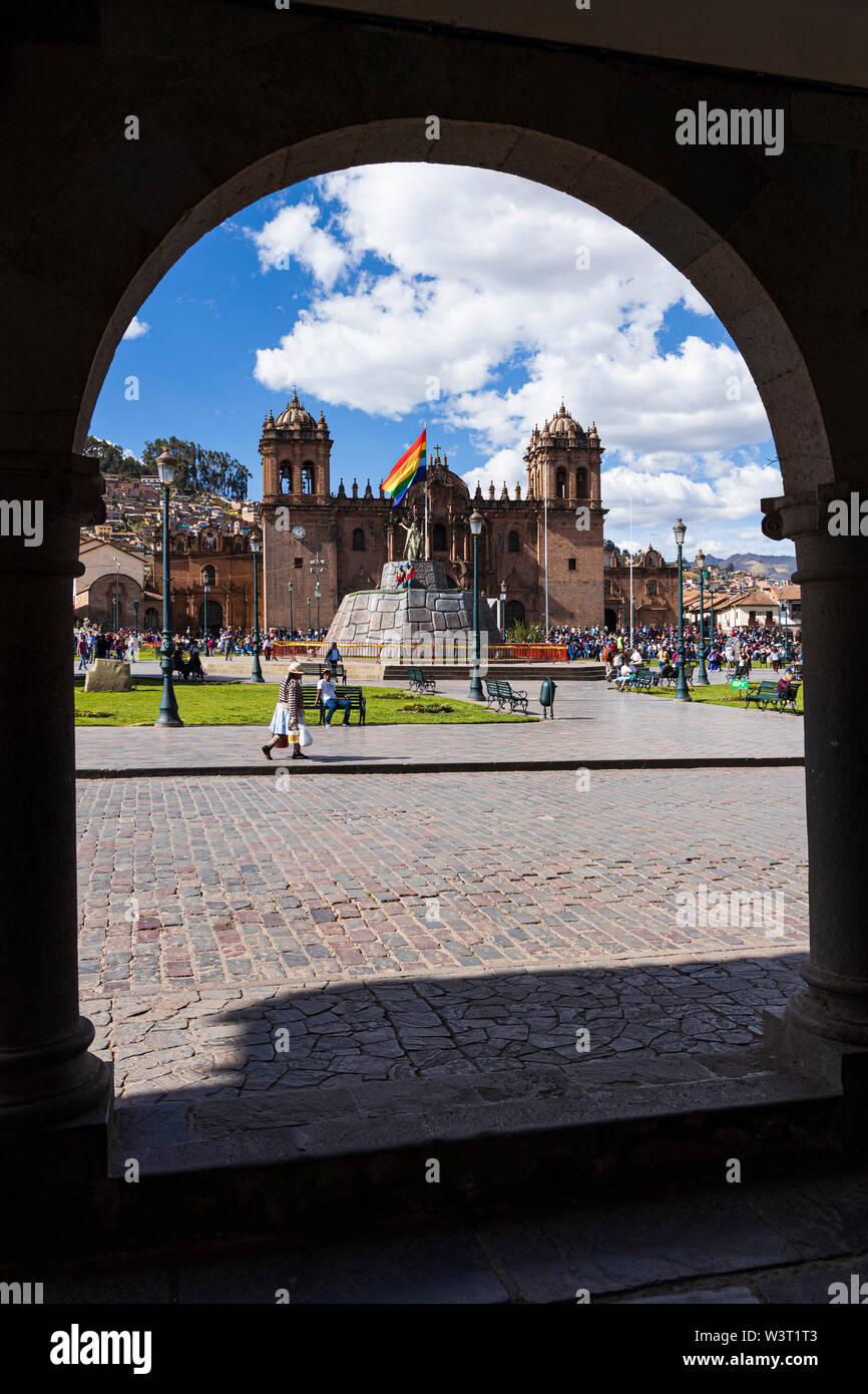 General view through the arches of the Plaza de Armas, Cathedral and Main square in Cusco, Peru, South America - Stock Image