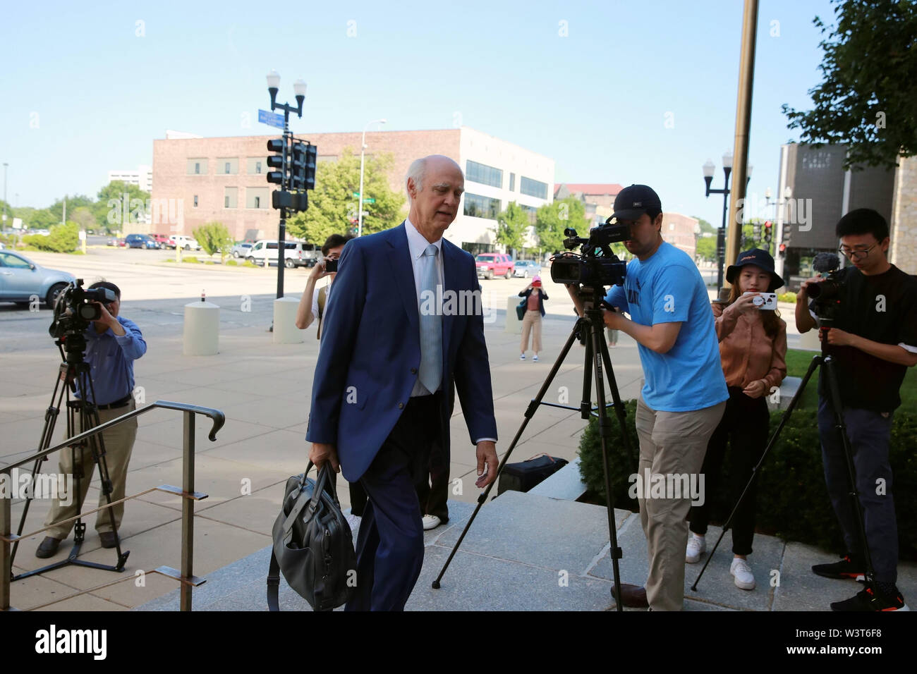 (190717) -- PEORIA (U.S.), July 17, 2019 (Xinhua) -- Robert Tucker, defense attorney for Brendt Christensen, heads to the federal courthouse building in Peoria, Illinois, the United States, on July 17, 2019. After a U.S. judge concludes all the evidence from the sentencing phase in the Chinese scholar slaying trial Tuesday, closing arguments from both prosecutors and the defense started here Wednesday morning. The closing arguments of the sentencing phase for Brendt Christensen who was found guilty of killing Zhang Yingying in 2017 took place around 9 a.m.(1400 GMT) at a federal court of Peori - Stock Image