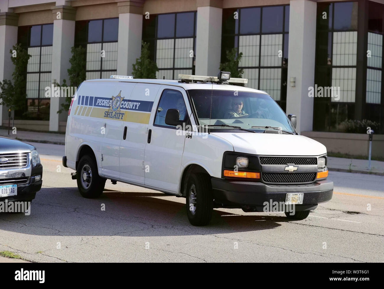 (190717) -- PEORIA (U.S.), July 17, 2019 (Xinhua) -- A Peoria County prison van carrying Brendt Christensen heads to the federal courthouse building in Peoria, Illinois, the United States, on July 17, 2019. After a U.S. judge concludes all the evidence from the sentencing phase in the Chinese scholar slaying trial Tuesday, closing arguments from both prosecutors and the defense started here Wednesday morning. The closing arguments of the sentencing phase for Brendt Christensen who was found guilty of killing Zhang Yingying in 2017 took place around 9 a.m.(1400 GMT) at a federal court of Peoria - Stock Image