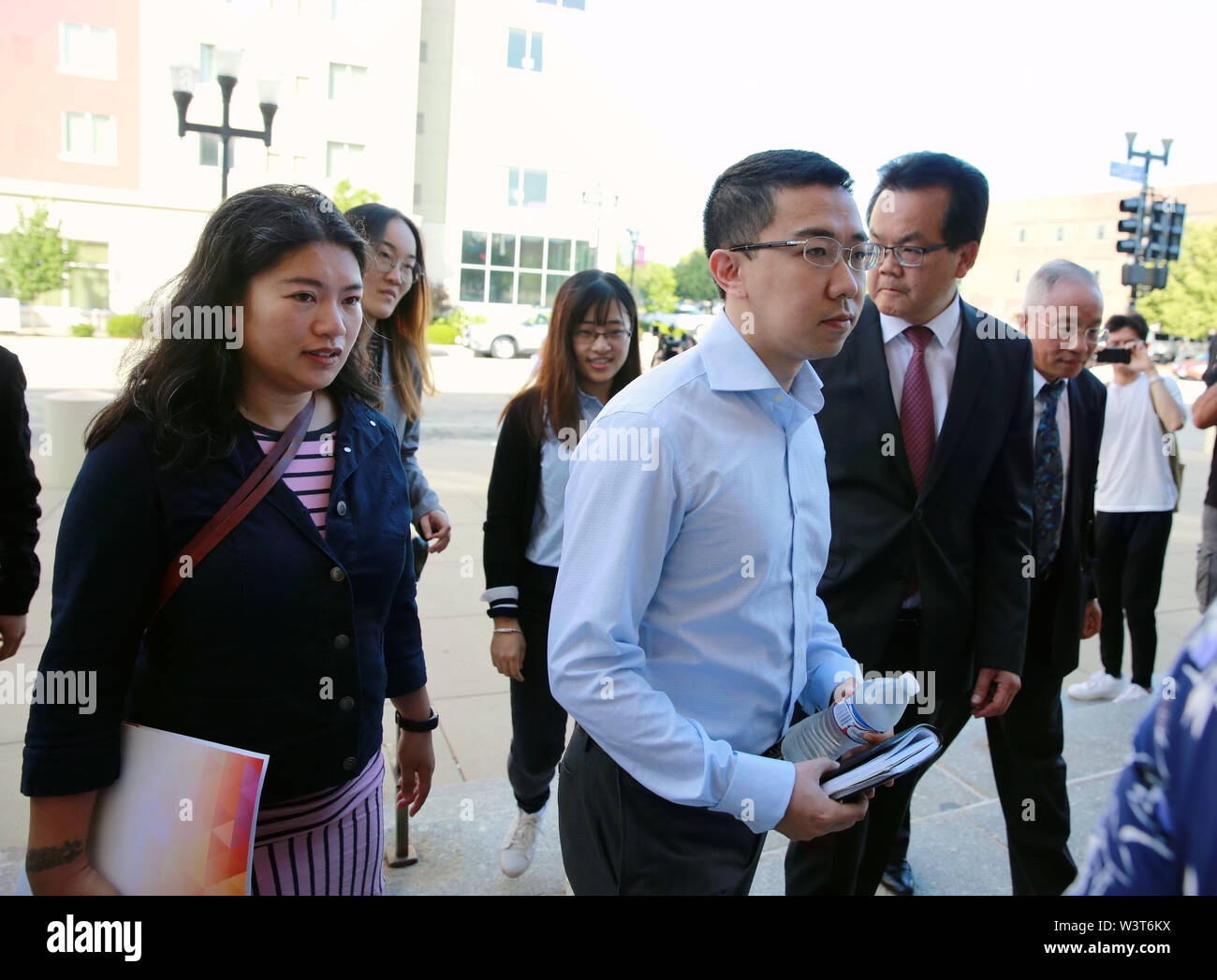 (190717) -- PEORIA (U.S.), July 17, 2019 (Xinhua) -- Family members of visiting Chinese scholar Zhang Yingying head to the federal courthouse building in Peoria, Illinois, the United States, on July 17, 2019. After a U.S. judge concludes all the evidence from the sentencing phase in the Chinese scholar slaying trial Tuesday, closing arguments from both prosecutors and the defense started here Wednesday morning. The closing arguments of the sentencing phase for Brendt Christensen who was found guilty of killing Zhang Yingying in 2017 took place around 9 a.m.(1400 GMT) at a federal court of Peor - Stock Image