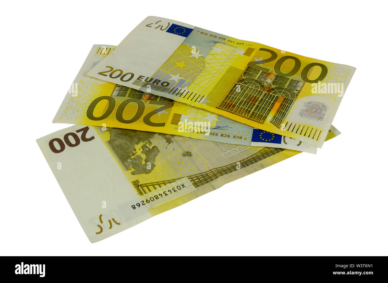 Two hundred Euros banknotes isolated on a white background - Stock Image